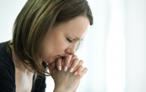 women suffering and thinking about counseling services